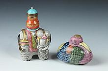 TWO CHINESE FAMILLE ROSE PORCELAIN ELEPHANT AND MANDARIN DUCK-FORM SNUFF BOTTLES, Qianlong mark. - Larger: 2 1/2 in. high.