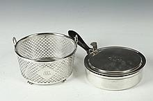 TIFFANY STERLING PIERCED ICE BUCKET WITH CRYSTAL LINER ALONG WITH A TIFFANY WARMING DISH, Early 20th Century, Marked Tiffany & Company.