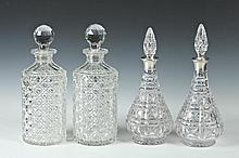 TWO PAIRS CUT COLORLESS CRYSTAL DECANTERS, ONE WITH STERLING COLLAR, 20th Century. - 12 1/8