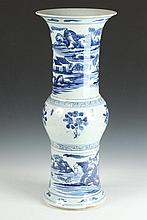 CHINESE BLUE AND WHITE PORCELAIN GU FORM VASE. - 27 in. high.