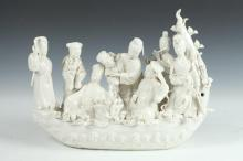 CHINESE BLANC-DE-CHINE PORCELAIN MODEL OF BOAT AND EIGHT IMMORTALS. - 16 in. long.