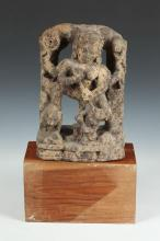 INDIAN SAND STONE RELIEF OF DURGA AND THE BUFFALO DEMON, circa 17th century. - 11 in. high.