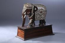INDIAN IVORY INLAID WOOD FIGURE OF ELEPHANT AND STAND, - 18 in. long.