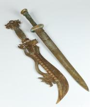 TWO CHINESE ARCHAISTIC BRONZE SWORDS, Shang dynasty style. - Larger: 24 1/2 in. high.