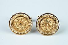 PAIR CHINESE CARVED 18K YELLOW GOLD DRAGON DESIGN MEDALLION CUFFLINKS.