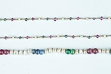 TWO FRESH WATER PEARL AND PRECIOUS COLORED GEMSTONE BEAD NECLACES.