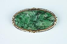 ANTIQUE CHINESE CARVED JADE, YELLOW GOLD AND SEED PEARL OVAL BROOCH. Late 19th century.