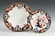 GROUP OF EIGHT DERBY CROWN PORCELAIN SOUP BOWLS, TWO BREAD PLATES, A SERVING BOWL, A PLATE & A CANDLESTICK IN THE IMARI PATTERN, Englis