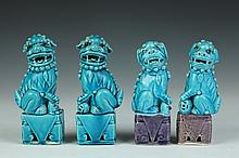 FOUR CHINESE TURQUOISE PORCELAIN FIGURES OF FU DOGS, Qing Dynasty. - Largest: 6 in. high.