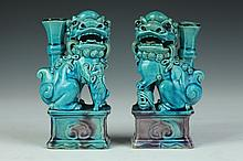 PAIR CHINESE TURQUOISE AND AUBERGINE PORCELAIN FIGURES OF FU LION-FORM JOSS STICK HOLDERS, Qing Dynasty. - 6 5/8 in. high.