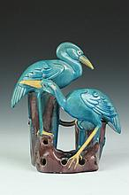 CHINESE TURQUOISE AND AUBERGINE PORCELAIN FIGURAL GROUP OF TWO CRANES. - 11 in. high.