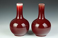 PAIR CHINESE COPPER RED PORCELAIN VASES, Jing De Zhen mark. - 11 1/2 in. high.