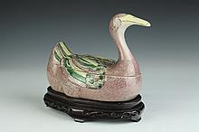 CHINESE SANCAI PORCELAIN DUCK-FORM JAR AND COVER. - 8 in. high.