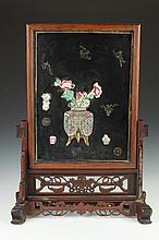 CHINESE FAMILLE ROSE PORCELAIN INSET BLACK LACQUERED WOOD TABLE SCREEN. - 26 1/2 in. high.