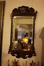 GEORGE III MAHOGANY AND PARCEL GILT FRET-CUT WALL MIRROR IN THE CHIPPENDALE TASTE. - H: 39