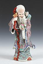 CHINESE FAMILLE ROSE PORCELAIN FIGURE OF IMMORTAL,