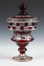 BOHEMIAN RED-CUT-TO CLEAR GLASS BONBON DISH AND COVER, Early 20th Century. - 10 3/4 in. high.
