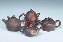 FOUR CHINESE YIXING POTTERY TEA POTS. - Largest: 3 3/4 in. high.