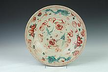 CHINESE SWATOW IRON RED AND GREEN DRAGON CHARGER, Ming Dynasty. - 14 in. diam.