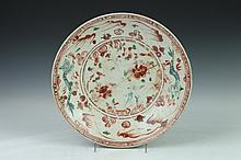 CHINESE SWATOW IRON RED AND GREEN DRAGON SHALLOW BOWL, Ming Dynasty. - 13 in. diam.