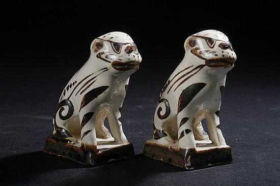 PAIR CHINESE CHOCOLATE AND BEIGE POTTERY FIGURES OF FU DOGS, 19th Century. - 3 in. high.