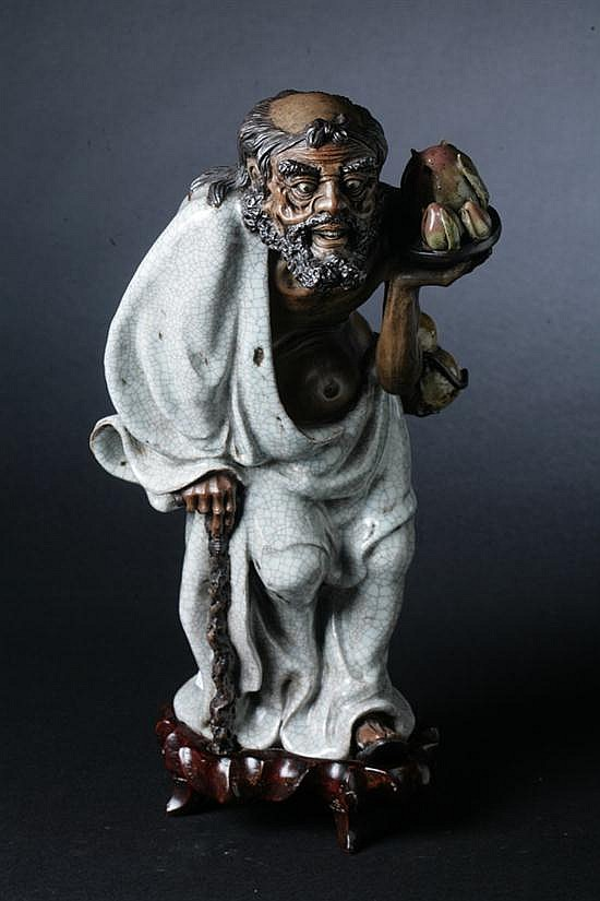 CHINESE GE-TYPE PORCELAIN FIGURE OF IMMORTAL, Late Qing/ early Republic Period. - 14 3/4 in. high.