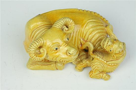 CHINESE YELLOW PORCELAIN FIGURE OF AN OX GROUP, Yongzheng seal mark, Republic Period. - 5 in. long.