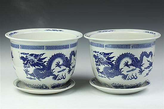 PAIR CHINESE BLUE AND WHITE PORCELAIN DRAGON JARDINIÈRES AND UNDERTRAYS, - 13 in. diam.