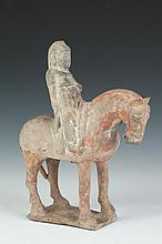 CHINESE POLYCHROME POTTERY EQUESTRIAN GROUP, Tang Dynasty. - 11 1/2 in. high.