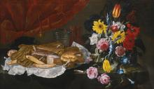 GIUSEPPE RECCO | Still life with roses, carnations, tulips and other flowers in a glass vase, with pastries and sweetmeats on a pewter platter, on a stone ledge in front of a red curtain