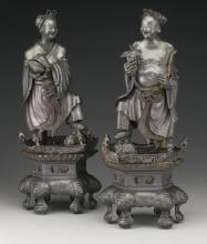 A PAIR OF PEWTER FIGURES OF IMMORTALSQING DYNASTY, 19TH CENTURY