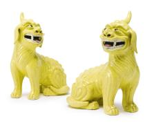 A PAIR OF CHINESE EXPORT PORCELAIN YELLOW-GLAZED FIGURES OF FU-DOGS19TH CENTURY