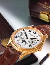 PATEK PHILIPPE | A FINE PINK GOLD AUTOMATIC PERPETUAL CALENDAR WRISTWATCH WITH MOON PHASES AND LEAP YEAR INDICATION<br />REF 3940 MVT 3124555 CASE 4043250 MADE IN1999
