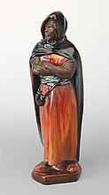 A Royal Doulton Orientalist figure 'The Moor' by Charles Noke, British 1858-1941, circa 1930