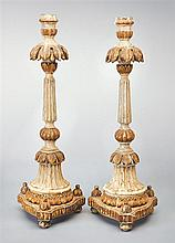A pair of Italian polychrome candlesticks, 18th century (2)