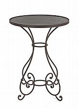 A small circular top ironwork table