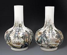 A pair of inscribed landscape bottle vases, 20th century (2)