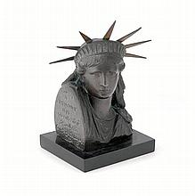 Frederick Auguste Bartholdi (1834-1904), a rare French patinated bronze, Paris 1878, depicting the head of the Statue of Liberty
