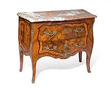 A French Louis XV ormolu mounted tulipwood, amaranth and sycamore marquetry commode, circa 1750