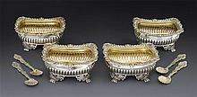 A matched set of four George III silver salt cellars, probably William Eaton, London 1813-1817, with spoons (8)