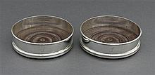 A pair of George III silver decanter coasters, William Allen III, London 1800
