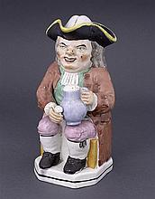 A Staffordshire Toby jug, with tricorn hat cover, circa 1820