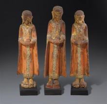 A set of three lacquered gilt and polychrome wood figures of monks, Burma (3)