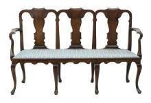 A George II provincial triple chair back settee, walnut and beech