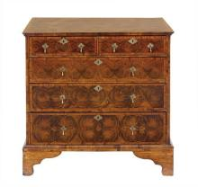 A George II oyster walnut chest of drawers, circa 1740