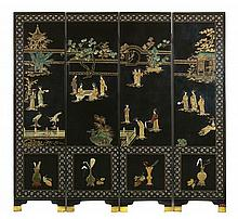 An embellished four panel black lacquer screen