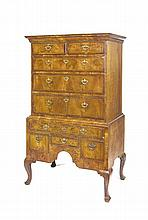 A George II walnut chest on stand, second quarter of 18th century