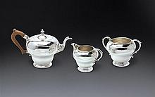 A rare George II/III silver teapot, sugar basin and creamer, maker probably George Hunter, London 1758 and 1760/2 (3)