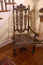 JACOBEAN STYLE CARVED WALNUT HALL CHAIR WITH NEEDLEPOINT