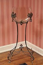 A WROUGHT AND FORMED IRON ART NOUVEAU FISH BOWL STAND